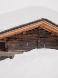 Snow covered roof with falling snow Royalty Free Stock Image