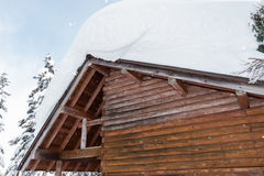 Snow covered roof of  hut in snowfall day. Snow covered roof of small hut in snowfall day Stock Photography