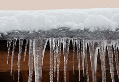 Snow covered roof with icicles. Bad weather, winter season concept, soft focus, shallow depth field. Snow covered roof with icicles. Bad weather, winter season Royalty Free Stock Photography