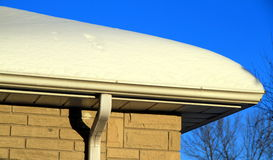 Snow Covered Roof Stock Photography