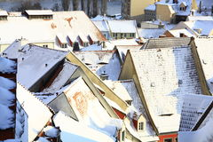 Snow covered roofs Stock Images