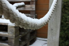 Snow covered rope and wooden pallets