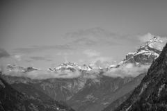 Snow Covered Rugged Mountain With Mist Photograph Stock Photography