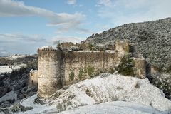 Snow-covered ruins of an ancient castle Stock Photography
