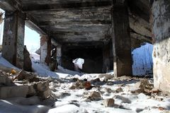 Snow-covered ruins with columns and pieces of bricks on the ground stock photo