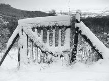 Snow covered rustic gate Stock Photos