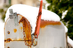 Snow covered rusty mailbox Stock Photography