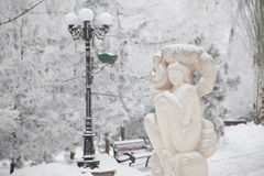 Snow-covered sculpture on a city winter boulevard Stock Photo
