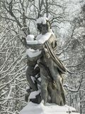 Snow-covered sculpture of a woman and a man stock photos