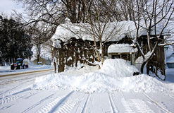 A snow-covered shed Stock Images