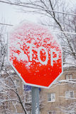 Snow-covered sign stop Royalty Free Stock Images