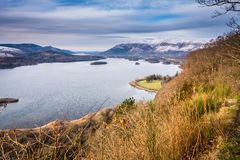 Snow covered Skiddaw above Derwent Water Stock Photography