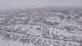 Snow-covered small town, aerial photography stock footage