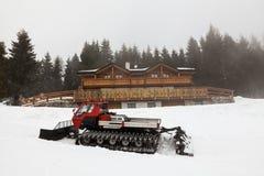 Snow covered snowplow in mountain Stock Photos