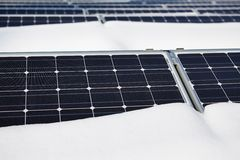 Snow-covered solar panel Stock Photo