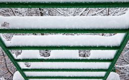 Snow covered sport stairs crossbar. macro view selective focus.  stock images