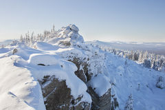 Snow covered spruces and rocks. Mountain Zyuratkul, winter lands Royalty Free Stock Image