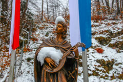 Snow covered Statue. Picture of a bronze statue covered in snow Stock Photo