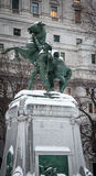 Snow covered statue Stock Images
