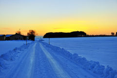 Snow covered street. Sunset with snow covered street Stock Photography