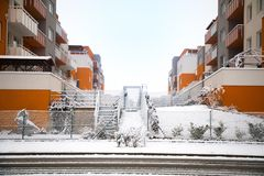 Snow covered street, fence and house. In Prague Royalty Free Stock Images