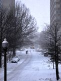On the snow-covered street. Royalty Free Stock Images