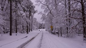 Snow covered street in residential neighborhood royalty free stock images