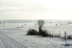 Snow covered swin golf course. On a cold, sunny winter day Royalty Free Stock Photography