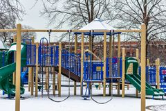 Swing Set at a Playground during Winter with Fresh Snow stock photography