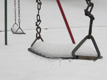 Snow covered Swing in the Winter Royalty Free Stock Image