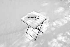 Snow covered table in the garden in winter Royalty Free Stock Photo
