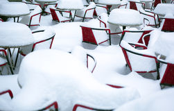 Snow Covered Tables and Chairs Royalty Free Stock Images