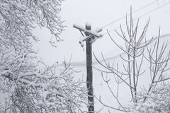 Snow Covered Telegraph Pole Royalty Free Stock Images
