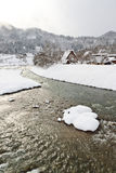 Snow covered thatched roof houses in Shirakawa-go Stock Photos
