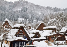 Snow covered thatched roof houses in Shirakawa-go Royalty Free Stock Photo