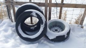 Snow Covered Tires Royalty Free Stock Photo