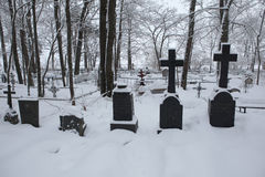 Snow-covered tombstones in Izborsk, Russia. Stock Photo