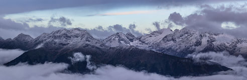 Snow-covered top of Greater Caucasus Mountain Range. Royalty Free Stock Image