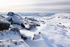 English landscape in winter. Snow covered tor landscape in winter, Kinder Scout, Derbyshire, England, UK Royalty Free Stock Photography