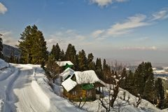 Snow covered tourist resort, Kashmir, Jammu And Kashmir, India. High angle view of snow covered tourist resort, Kashmir, Jammu And Kashmir, India royalty free stock images