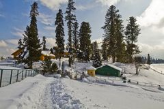 Snow covered tourist resort, Kashmir, Jammu And Kashmir, India. Tourist resort on a snow covered landscape, Kashmir, Jammu And Kashmir, India stock photos