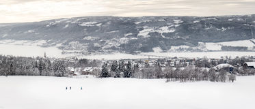 Snow covered town by a lake Stock Photo