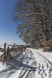 Snow covered track in countryside Royalty Free Stock Images