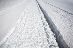 Snow covered track in winter Royalty Free Stock Image