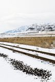 Snow-Covered Tracks. With snowy mountain in the background stock photography