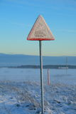 Snow covered train sign. On sunset Royalty Free Stock Photo