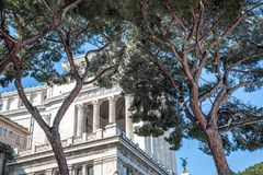 Altare della Patria Backside with Trees. Snow-covered trees behind the Alter of the Fatherland in Rome, Italy Royalty Free Stock Photography
