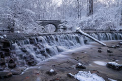 Snow Covered Trees. Framing A Stone Bridge And Waterfall During Winter In The Park, Sharon Woods, Southwestern Ohio, USA Royalty Free Stock Photo