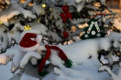 Snow-covered trees in the park, decorated with Christmas toys.  royalty free stock photos