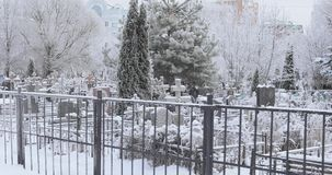 Snow covered cemetery. Snow-covered trees and a road along a small cemetery stock footage